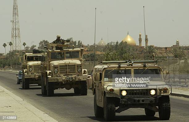 US military vehicles roll down the road 30 June 2003 in Samarra some 175 kms north of Baghdad on the way to toppled leader Saddam Hussein's hometown...