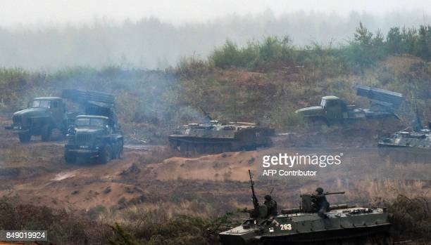 Military vehicles take positions during the joint RussianBelarusian military exercises Zapad2017 at the Luzhsky training ground in the Leningrad...