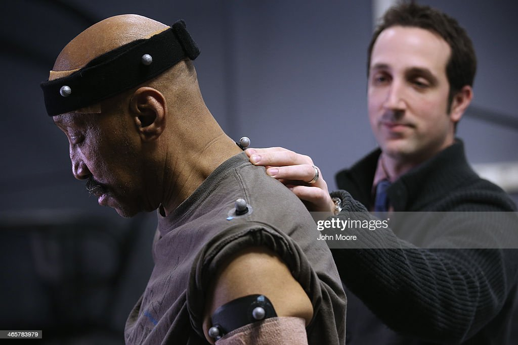 U.S. Military veteran and amputee Lloyd Epps has reflective devices placed on his body by Jason Maikos, director of the gait and motion analysis lab at the Veterans Administration (VA), hospital on January 29, 2014 in Manhattan, New York City. Epps, who lost his leg to an infection in 2010, wears a hightech custom prosthetic leg from the VA which actually powers his gait forward. At the gait and motion lab patients are fitted with reflectors which are filmed by multiple cameras and later analyzed to help them improve mobility after losing limbs.