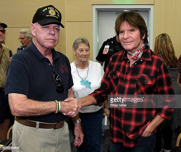 US military veteran Fred L Herr and his wife Peggy Herr greet recording artist John Fogerty after he performed with SixString Soldiers a fourmember...