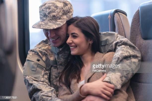 Military veteran hugging his wife