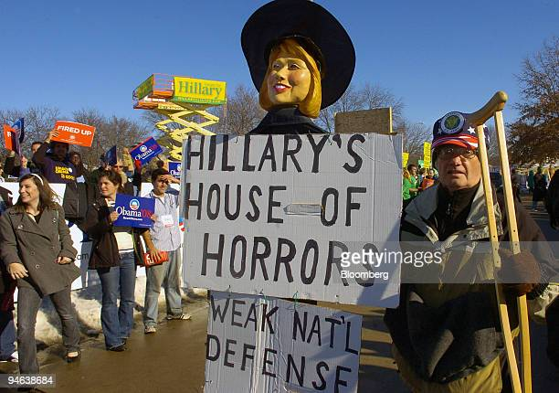 Military veteran John Strong of West Des Moines Iowa carries a display depicting US Senator Hillary Clinton as a witch outside a debate among...