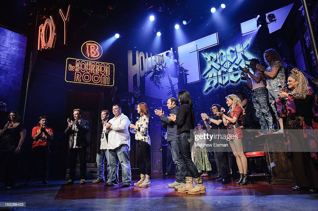 U.S. Military Veteran Jon Moldovan (C) and 'Rock Of Ages' cast members attend the 'Rock Of Ages' on Broadway Military Tribute Night at Helen Hayes Theatre on October 2, 2012 in New York City.