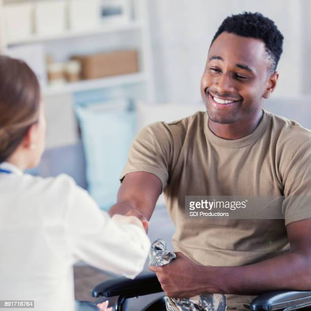 Military veteran shakes hands with therapist