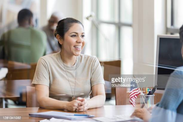 military veteran talks with loan officer - stars and stripes stock pictures, royalty-free photos & images