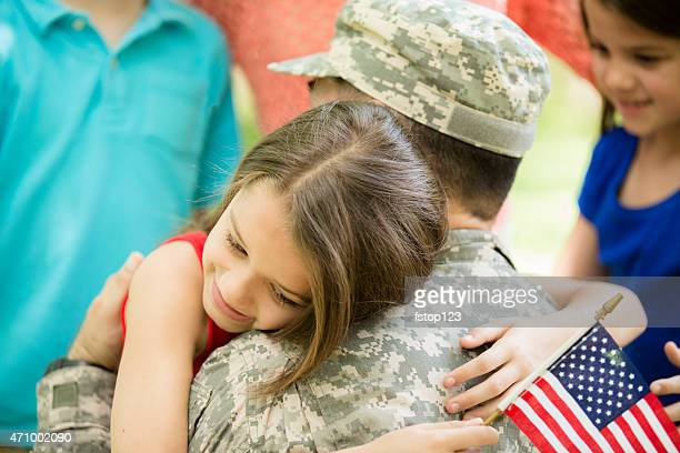 u.s. military veteran welcomed home by family. children, hugs. - veterans day stock photos and pictures