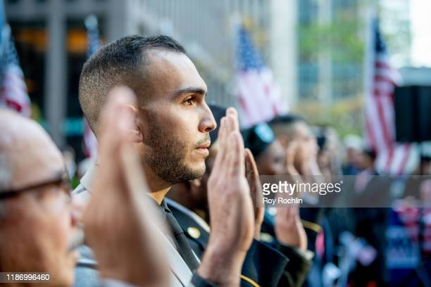 """Military veterans and active duty honorees saying the """"Pledge of Allegiance"""" as they receive their U.S. Citizenship during """"Fox & Friends""""..."""