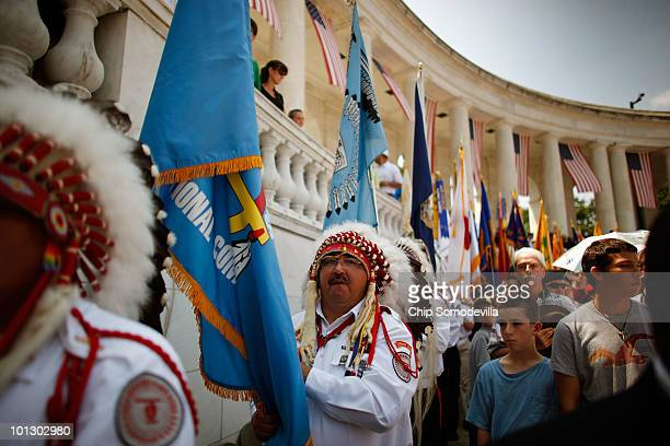 S military veterans and members of the Blackfeet Tribe from Browning Montana carry flags during Memorial Day ceremonies at Arlington National...