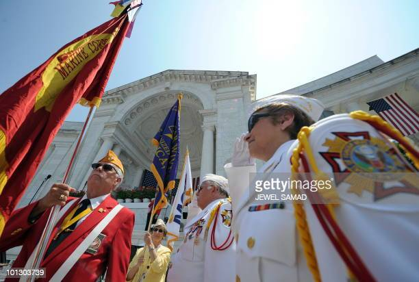 US military veterans and members of the Blackfeet Tribe from Browning Montana carry flags during a Memorial Day ceremony at Arlington National...
