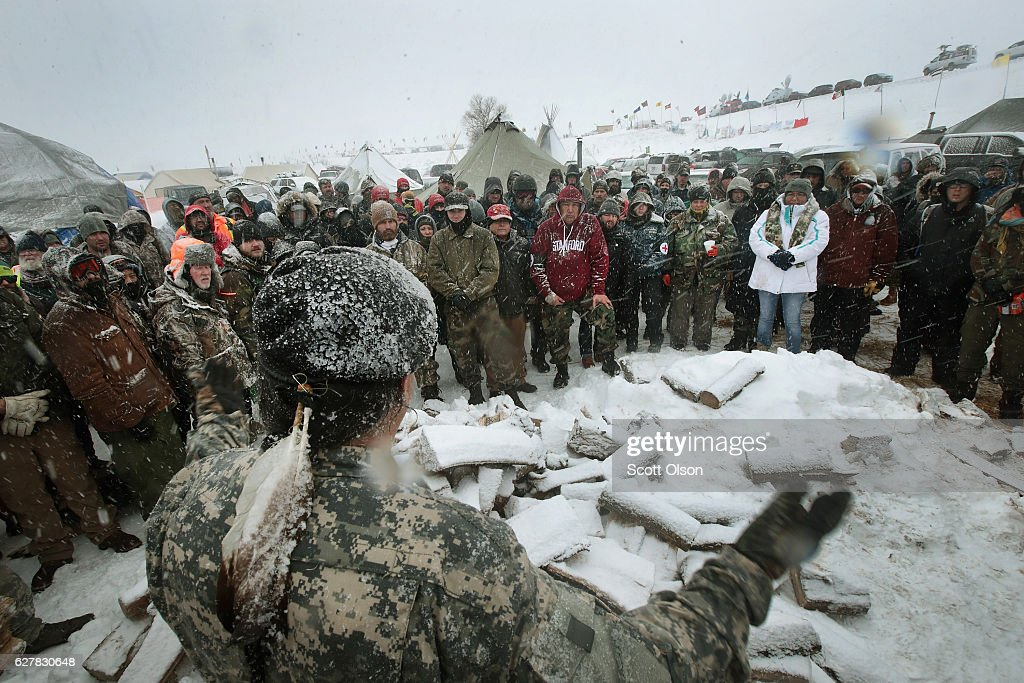 Military veterans are briefed on cold-weather safety issues and their overall role at Oceti Sakowin Camp on the edge of the Standing Rock Sioux Reservation on December 5, 2016 outside Cannon Ball, North Dakota. Over the weekend a large group of military veterans joined native Americans and activists from around the country who have been at the camp for several months trying to halt the construction of the Dakota Access Pipeline. Yesterday the US Army Corps of Engineers announced that it will not grant an easement for the pipeline to cross under a lake on the Sioux Tribes Standing Rock reservation. The proposed 1,172-mile-long pipeline would transport oil from the North Dakota Bakken region through South Dakota, Iowa and into Illinois.