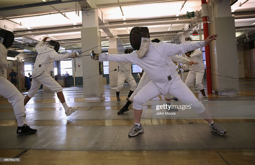 U.S. military veterans fence as part of the Veterans On Guard Fencing program on January 29, 2014 in Manhattan, New York City. The program, held at New York City's Fencing Club and helped sponsored by the Veterans Administration (VA), began this year with a group of 10 veterans, who learn the sport from professionals. The VA promotes adaptive sports programs, free for military veterans, as a way to keep vets active and healthy after their military service is done.