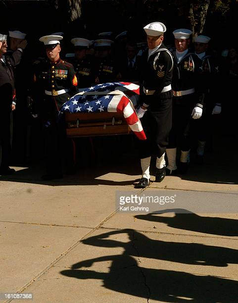 MILAMFUNERAL Military veterans from the Patriot Guard Riders saluted the casket of Navy corpsman Luke Milam as it was carried by a military honor...