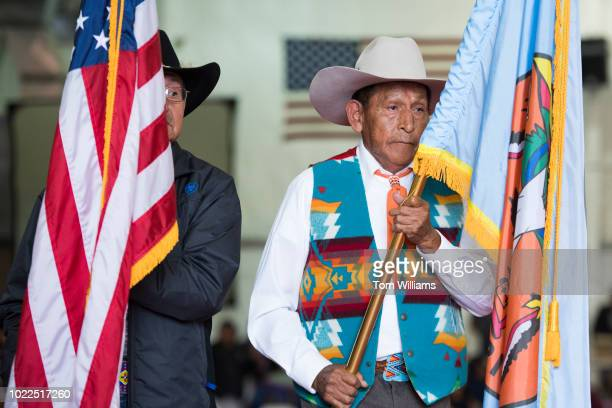 Military veterans participate in a pow wow at Crow Fair in Crow Agency Mont on August 18 2018 Reps Greg Gianforte RMont Bruce Westerman RArk and...