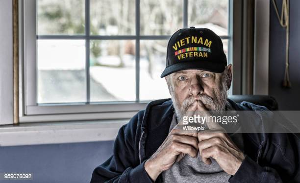 USA Military Vietnam War Veteran With Fingers on Mouth