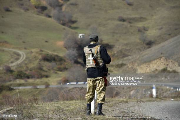 Military volunteer keeps watch in the Shusha region on October 31 amid the ongoing military conflict between Armenia and Azerbaijan over the...