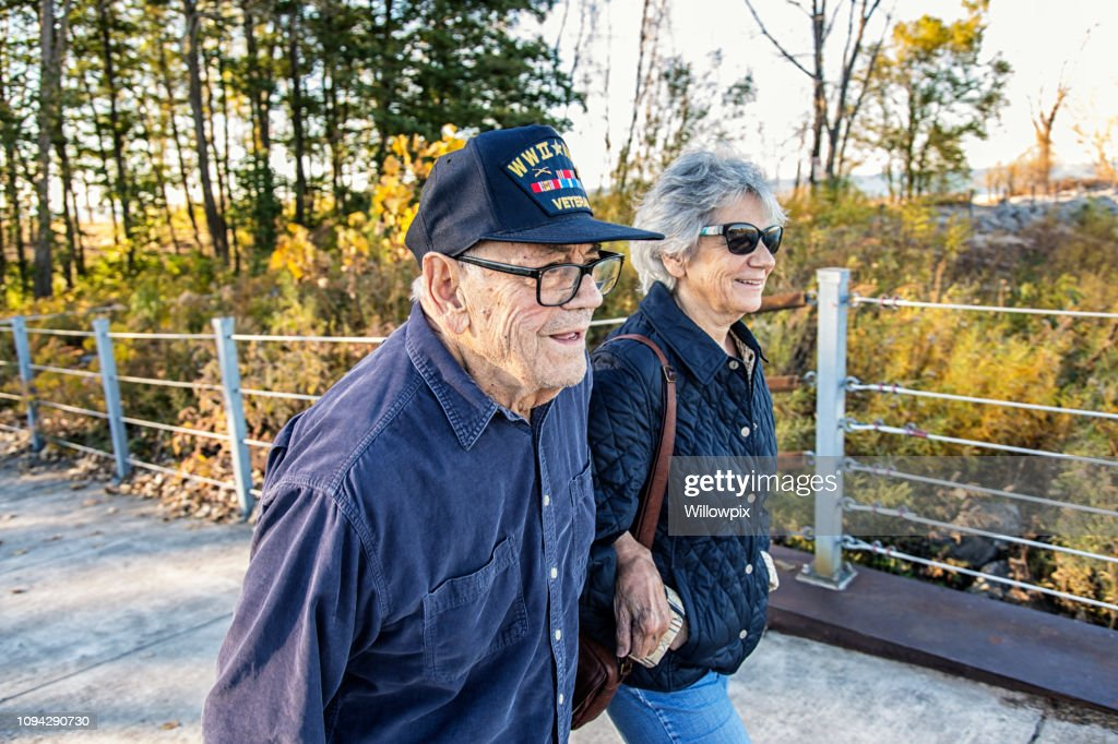 WWII USA Military War Veteran Father and Daughter Walking : Stock Photo