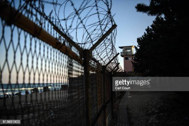 A military watchtower overlooks a fenced beach near the Korean Demilitarized Zone on February 3 2018 near Goseonggun South Korea The Demilitarized...