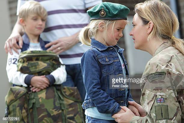 military woman leaving for service , family