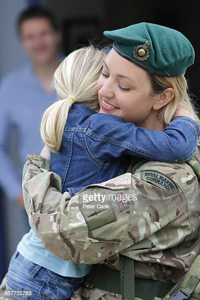 military woman returning home, family, cuddle