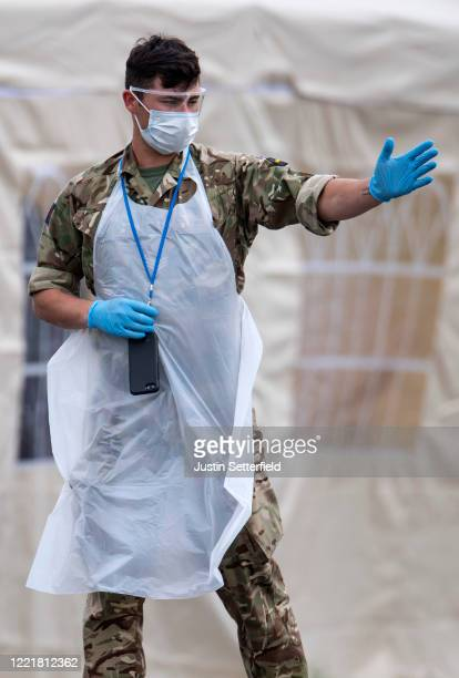 Military work at a mobile drive in coronavirus testing unit for key workers at Barking Hospital on April 29, 2020 in London, England. British Prime...