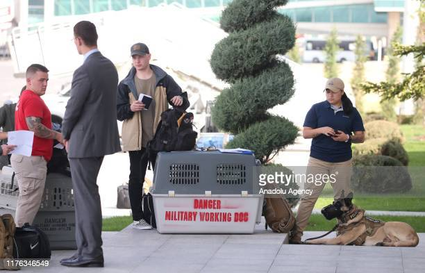 Military working dogs are seen as US Vice President Mike Pence arrives at Esenboga Airport in Ankara Turkey on October 17 2019