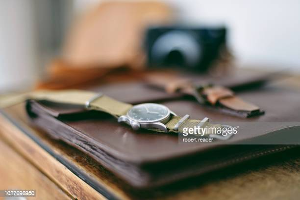 military wristwatch on wooden cabinet - time management stock photos and pictures