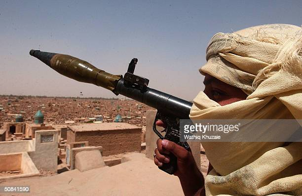 u.s., militia clash in najaf - iraq stock pictures, royalty-free photos & images