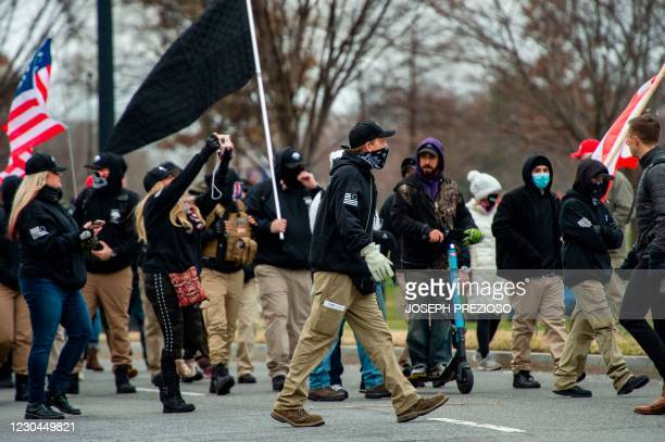 Militia like group makes their way to a rally for US President Donald Trump in Washington, DC on January 6 as a total of six buses and about 300...