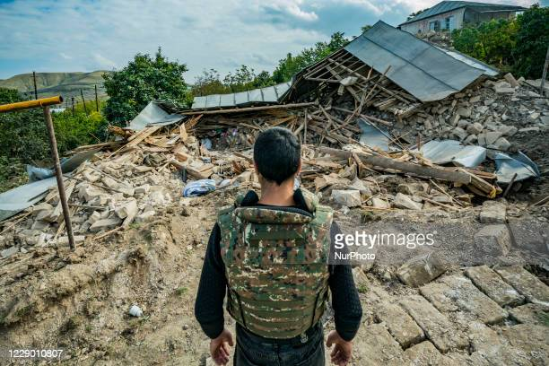 Militia man looks the ruins of a destroyed house in Martuni village by an azeri rocket during the clashes between the Nagorno Karabakh and Azerbaijan...