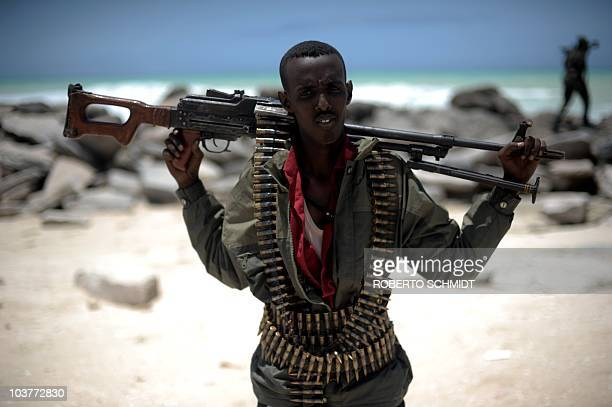 MOJON A militia man stands on a beach in the town of Hobyo on August 20 2010 The fledging Galmadug administration in Central Somalia says it lacks...