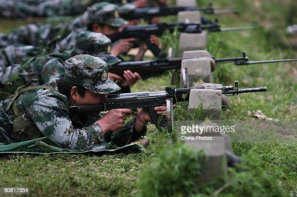 Militia soldiers demonstrate shooting during Nanjing's first antiterror militia emergency drill at a training base on April 21 2008 in Nanjing of...
