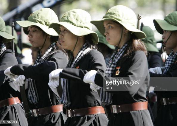 Militia women dressed in Vietnam war time uniforms, parade during