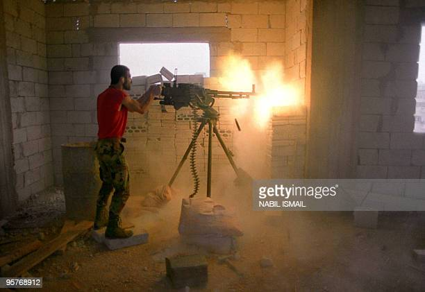 Militiaman from Amal the first political organization of Lebanon's Shi'ite Moslems fire from a heavy machine gun 17 May 1988 in the Shi'ite southern...