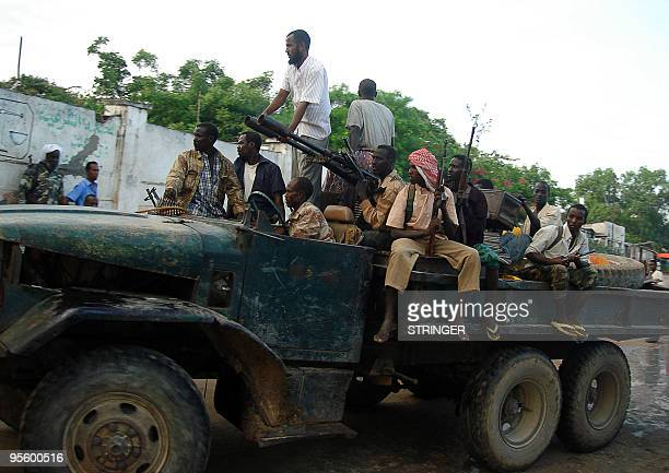 Militiamen defected from the Somalian government ride a truck loaded with anti aircraft '' twins'' gun and as they are welcomed to join Islamists in...
