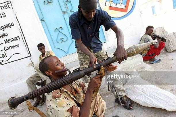 Militiamen from the Hizbul Islam fighters load a rocket launcher during clashes with Somali authorities in the vicinity of the presidential palace in...