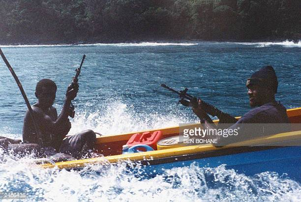 Militiamen loyal to renegade warlord Harold Keke patrol the coast where hostages Father Peter Kesimo Father Alfred Tabo and Father Benjamin Kunu are...