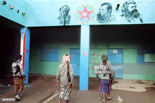 Militiamen partisans of Yemen Socialist Party senior leader Abdul Fattah Ismail walk in an abandoned post of President Ali Nasser Mohammad supporters...