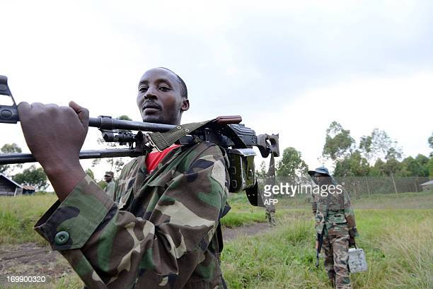 M23 militiamen patrol on June 3 2013 on the front line in Mutaho 15kms away from Goma 4kms away from the FARDC A special UN intervention brigade to...
