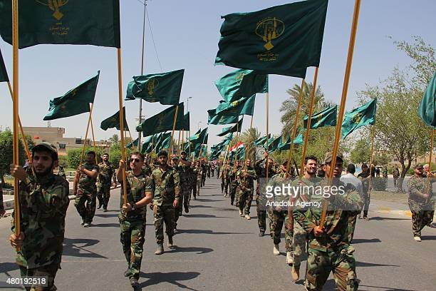 Militia's of alHashd alShaabi march during a military parade during the AlQuds Day in Baghdad Iraq on July 10 2015