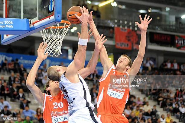 Milivoje Bozovic, #8 of Hemofarm Stada,Boban Marjanovic, #20 competes with Marijonas Petravicius, #15 of Lietuvos Rytas during Eurocup Basketball...