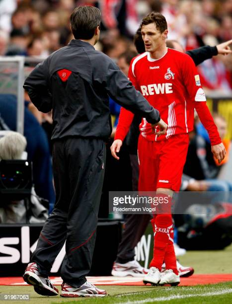 Milivoje Novakovic of Koeln and head coach Zvonimir Soldo are pictured during the Bundesliga match between 1 FC Koeln and FSV Mainz 05 at...