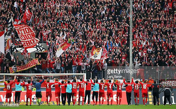 Milivoje Novakovic of Koeln and his team mates celebrate with the fans after winning the Bundesliga match between 1 FC Koeln and 1 FC Nuernberg at...