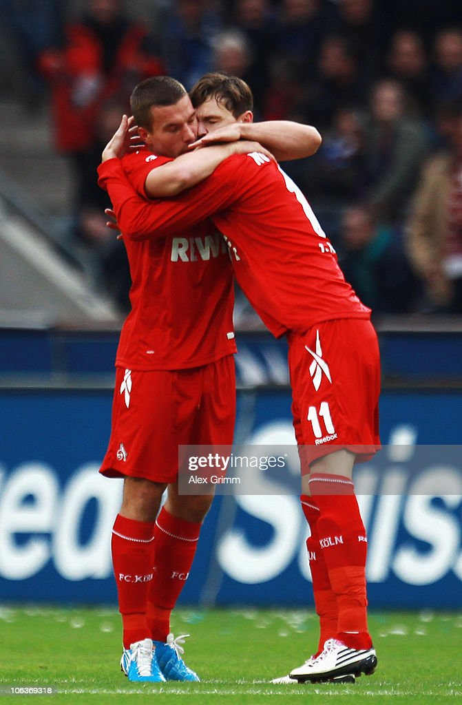 Milivoje Novakovic (R) of Koeln celebrates his team's first goal with team mate Lukas Podolski during the Bundesliga match between 1 FC Koeln and Hamburger SV at the RheinEnergieStadion on October 30, 2010 in Cologne, Germany.