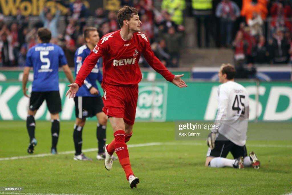 Milivoje Novakovic of Koeln celebrates his team's second goal as goalkeeper Jaroslav Drobny of Hamburg reacts during the Bundesliga match between 1 FC Koeln and Hamburger SV at the RheinEnergieStadion on October 30, 2010 in Cologne, Germany.