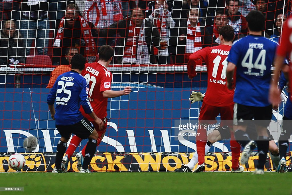 Milivoje Novakovic (2R) of Koeln scores his team's third goal during the Bundesliga match between 1 FC Koeln and Hamburger SV at the RheinEnergieStadion on October 30, 2010 in Cologne, Germany.
