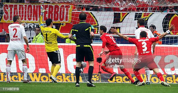 Milivoje Novakovic of Koeln scores his teams winning goal during the Bundesliga match between 1 FC Koeln and 1 FC Nuernberg at RheinEnergieStadion on...