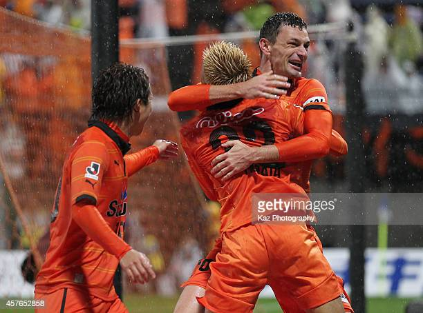 Milivoje Novakovic of Shimizu SPulse celebrates scoring his team's second goal with his teammates Kazuya Murata and Genki Omae during the JLeague...