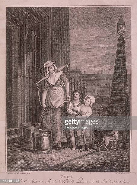 'Milk below Maids' A milk seller handing a cupful of milk to a boy and girl on a London street with a dog walking past and a lamp on the right From...