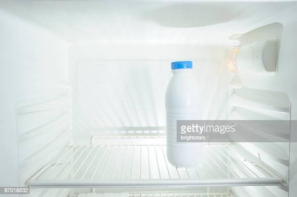 Milk bottle in refrigerator