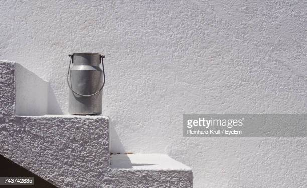 Milk Canister On Steps By Wall